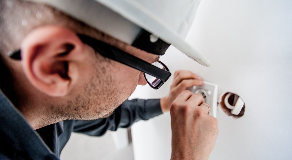Skilled worker carrying out electrical work
